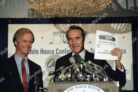 Senate Majority Leader Sen. Robert Dole of Kansas holds copy of the final recommendation of the White House Conference on Small Business during a news conference at the conclusion of the conference in Washington, . With Dole is Ralph Stanley executive director of the conference