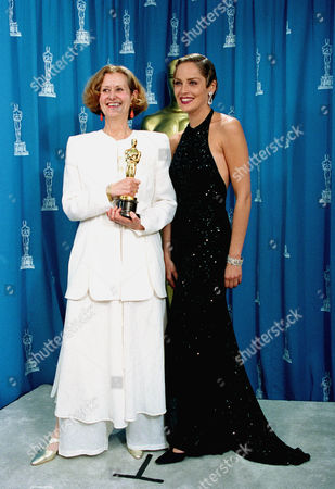"""Actress Sharon Stone, right, poses with designer Gabriella Pescucci, at the Academy Award in Los Angeles, . Pescucci won an Oscar for Best Costume Design for the movie, """"The Age of Innocence."""" Stone was the presenter for the """"best costume"""" category at the ceremony"""