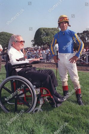 Shoemaker Pincay Former jockey Willie Shoemaker, left, chats with jockey Laffit Pincay Jr. at the Santa Anita track in Arcadia, Ca., . Shoemaker, now a horse trainer, makes his first return to the track after an auto accident last April which left him paralyzed from the neck down