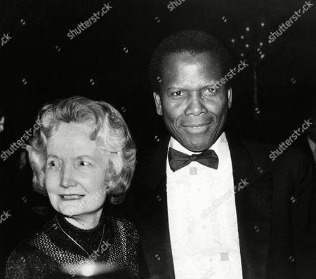 """Susie Tracy arrives with actor Sidney Poitier for a tribute to her father, the late actor Spencer Tracy, at the American Academy of Dramatic Arts' """"A Tribute to Spencer Tracy,"""" at New York's Majestic Theater in New York"""
