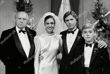 "Watchf Associated Press Domestic News Entertainment California United States APHS49383 SLIVER SPOONS WEDDING Cast members, left to right, John Houseman, Erin Gray, Joel Higgins, and Ricky Schroder get together in Los Angeles for a wedding picture during the taping of the NBC television series ""Silver Spoons"" for an upcoming episode"