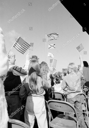 Some 50,000 students, teachers and parents from 67 public schools in the Kennedy Space Center area in Cocoa, Florida, took part in a special flag raising program to honor the crew of Challenger. Here students at Challenger 7 Elementary School look on as the ?Learning and Liberty? flag is raised during formal dedication ceremonies for their school. The flag is a special symbol of education; Christa McAuliffe carried one aboard challenger