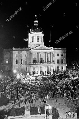 An estimated crowd of 2500 peopled gather around the foot of the Statehouse steps in Concord, New Hampshire, to participate in a memorial service for Concord High School teacher Christa McAuliffe who was killed in the space shuttle Challenger explosion on Tuesday