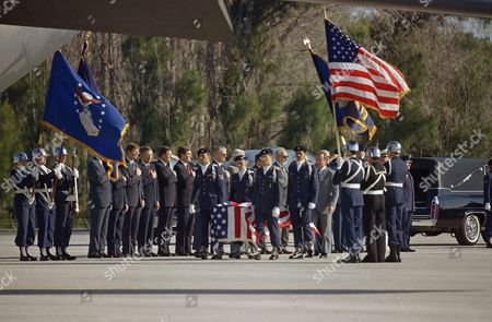 The body of the first teacher chosen for space, Christa McAuliffe, is carried by an honor guard to a C-141 Starlifter jet in Florida, where she and six other Space Shuttle Challenger astronauts will be flown to Dover, Del. The Astronauts were killed in Mission 51-L on January 28th