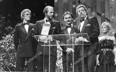 The Statler Brothers, Phil Balsley, Don Reid, Jimmy Fortune, and Harold Reid, from left, accept one of their six awards during the annual TNN/Music City News Country Awards show at the Grand Ole Opry House in Nashville, Tenn., on