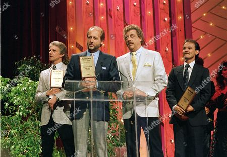The Statler Brothers, Phil Balsley, Don Reid, Harold Reid, and Jimmy Fortune, from left, accept their awards as Entertainer of the Year at the 21st annual Country Music Awards show in Nashville, Tenn., on