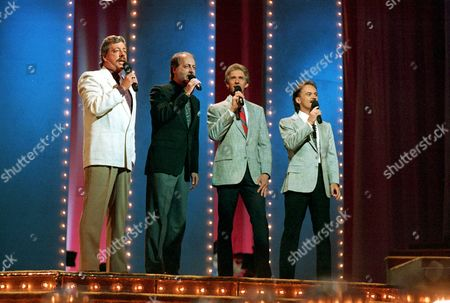 """FORTUNE Country music signing group,"""" The Statler Brothers,"""" perform June 5,1989 at the 23rd annual Music City News Country Awards show in Nashville,Tenn. From left, are: Harold Reid, Don Reid, Phil Balsley and Jimmy Fortune"""
