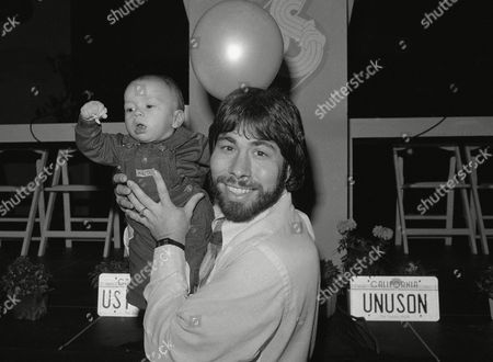 Six-month-old Jesse John Clark makes a gesture of confidence in his father, computer whiz Steve Wozniak during a new conference at which Wozniak announced his plans for a second US Festival for the Memorial Day weekend, in Los Angeles, . The child was born during the first US Festival the previous September, an extensive rock music and computer technology celebration near San Bernadino, Calif
