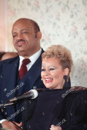 Tammy Faye Bakker answers reporter's questions during a luncheon in Los Angeles, as a guest of reverend Edward V. Hill, left, who was celebrating his 29th pastoral anniversary. Bakker refused to answer any questions regarding legal action which may be pending for her husband Reverend Jim Bakker