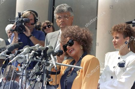 Tammy Faye Bakker, wife of former PTL leader Jim Bakker, gestures as she talks to reporters with attorney Harold Bakker background, outside the federal Courthouse in Charlotte, North Carolina, . Jim Bakker's sentence was reduced to 18-years on his fraud and conspiracy conviction