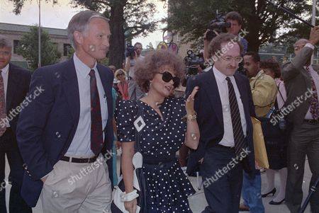 Dershowitz Bakker Tammy Faye Bakker, wife of the former PTL leader Jim Bakker, throws a kiss as she arrives at the federal courthouse in Charlotte, N.C. for her husband's resentencing hearing on a 45-year prison sentence, . Attorney Alan Dershowitz is at her right