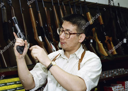 David Chu, manager of the Western Gun Shop shown here on in the Korea town section of Los Angeles, displays a 45-caliber handgun at the stores. Chu says gun sales have been increasing as a verdict approaches in the second Rodney King beating trial