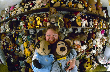 Stock Photo of Lilly Andrews hugs a pair of her 3,000 teddy bears in her Pittsburgh, Pa., home, 1986. Andrews and her husband, Milt, have been accumulating the furry toys from flea markets, shops and garbage cans for the past four years
