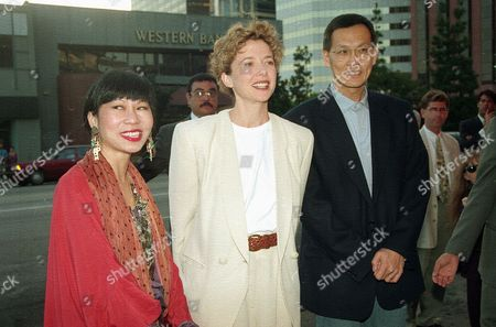 "Actress Annette Bening poses between author Amy Tan and director Wayne Wang, after a screening of the motion picture ""The Joy Luck Club,"" in the Westwood section of Los Angeles, Calif., on . Wang directed the film based on a novel by Tan"