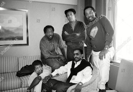 """Stock Photo of Allie Ollie Woodson, Ron Tyson, Otis Williams, Richard Street, Melvin Franklin The """"Temptations"""" at the Parker Meridian Hotel in New York City, . Sitting on the floor is Allie Ollie Woodson, Ron Tyson, seated; Standing, Otis Williams, Richard Street and Melvin Franklin"""