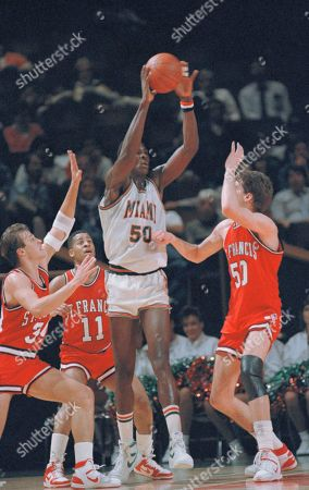 "Miami's Tito Horford, at 7'1"", towers over St. Francis forward Bob Gullickson (50), guard Greg Jacobs (11) and center Jerry Mack, right, (50) at mid-court during game between the Hurricanes and the Red Flash of Landsdowne, Pa., at the Knight Center in Miami, . The Hurricanes got help from center Horford, who scored 21 points and 10 rebounds and guard Kevin Presto for their 85-82 victory St. Francis"