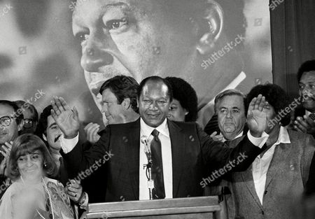 Los Angeles Mayor Tom Bradley reacts to supporters' cheers in Los Angeles during the early hours of returns in the state gubernatorial race. Bradley lost in a very close race to Republican challenger George Deukmejian