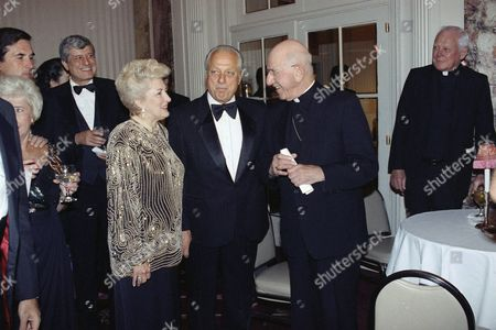 Los Angeles Dodgers manager Tommy Lasorda, center, and his wife, Jo, chat with the Rev. Francis Mugavero, retired Roman Catholic bishop of Brooklyn and Queens, at the Columbus Citizens Foundation dinner on in New York. Lasorda and Rev. Mugavero received Lifetime Achievement Awards from the group, organizers of the annual Columbus Day Parade; Lasorda is to act as the parade?s grand marshall