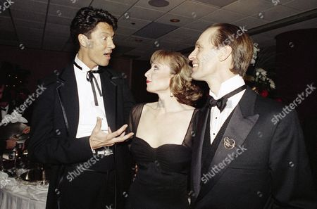 """Tommy Tune, Keith Carradine Director and choreographer Tommy Tune, left, makes a point during a chat with Broadway stars Dee Hoty, center, and Keith Carradine, right, at the opening night party for the musical """"Will Rogers Follies"""" in New York on . Carradine plays the well-known humorist Will Rogers in the production that opened at the Palace Theatre on Broadway"""