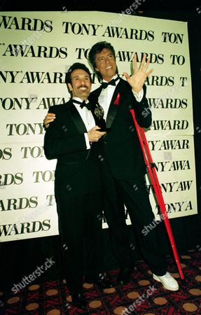 "Crivello Tune Tony winner Anthony Crivello, left, and presenter Tommy Tune are shown backstage at the 47th Annual Tony Awards show held at the Gershwin Theatre in New York City, . Crivello won best actor in a musical for his role in ""Kiss of the Spider Woman."" Tune broke a bone in his foot recently and appears with red crutches"