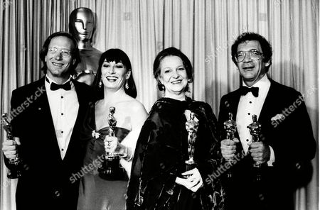 "The top-winners of the 58th annual Academy Awards pose with their Oscars, at the Music Center in Los Angeles, Calif., on . From left are : William Hurt, best actor for ""Kiss of the Spider Woman,"" Anjelica Huston, best supporting actress for ""Prizzi's Honor,"" Geraldine Page, best actress for ""The Trip to Bountiful,"" and director and producer Sidney Pollack, best picture for ""Out of Africa"