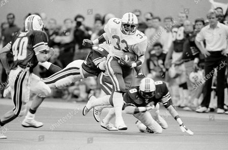 Stock Image of George Adams, Mike Landry, Kevin Tate University of Kentucky fullback George Adams (33) scampers around the left side of the Tulane defense during first quarter action in New Orleans, . Kevin Tate (8) right cornerback for Tulane finally brought Adams down but not before a Kentucky first down. Also in on the play is Tulane linebacker Mike Landry (49). The Wildcats and Green Wave were tied at 17-17 at the half
