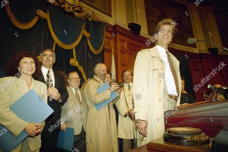 "Stock Photo of Cheers"" television actor Rhea Perlman, left, who plays Carla Tortelli, and other ""Cheers"" personalities listen as fellow cast member Ted Danson, who plays Sam Malone, right, address the Massachusetts State Legislature during the ""Cheers Day"" proclamation at the Statehouse in Boston"