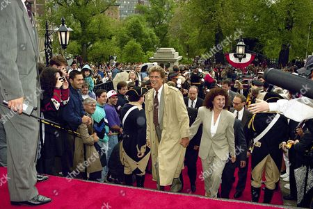 "Stock Picture of Ted Danson Cheers"" television actors Ted Danson, who plays Sam Malone, and Rhea Perlman, who plays Carla Tortelli, walk up the steps of the Statehouse in Boston as they arrive for the official proclamation of ""Cheers Day"" in Massachusetts by Governor William Weld"