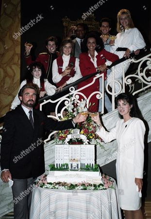 """Stock Picture of Valerie Landsburg, Susan Walters, Nathan Cook, Shari Belafonte, Michael Spound, Heidi Bohay, James Brolin, Connie Selleca The TV show """"Hotel"""" celebrated the shooting of its 100th episode on stage four at Burbank Studios, . The cast poses for the occasion, left to right: James Brolin and Connie Sellecca, in front and on the stairs Valerie Landsburg, Susan Walters, Nathan Cook, Shari Belafonte-Harper, Michael Spound and Heidi Bohay"""