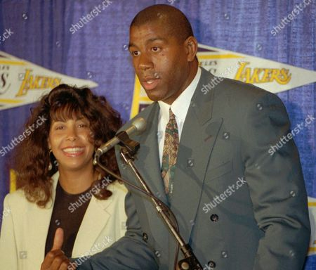 """Stock Photo of JOHNSON Earvin """"Magic Johnson"""" and his wife Cookie are shown at a news conference in Inglewood, Calif., where Johnson announced he would return as a player for the Los Angeles Lakers. He later retired again from the team. In an article in Ebony Magazine, Cookie Johnson says her husband has recovered from the AIDs virus. Johnson's HIV infection has dropped to undetectable levels because of drug therapy, doctors say. Lon Rosen, agent for the former Los Angeles Lakers star, confirmed: ''Earvin's viral activity is infinitesimal"""