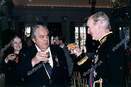 Film producer Albert Broccoli, known as Cubby Broccoli, is toasted by British Ambassador Sir Antony Acland during a reception at the British Embassy in Washington, USA on . Broccoli was presented with the Order of the British Empire for this outstanding contribution to the British film industry. Broccoli produced several of the James Bond films
