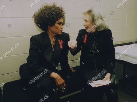 1993 image of U.S. American singer and actress Eartha Kitt as she listens to veteran actress Geraldine Fitzgerald