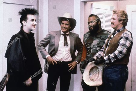 "Boy George on the Range in ""The A-Team"" - British pop star Boy George, left, guest-stars as himself on June 5, 1986, at Saugus, California near Los Angeles, United States, when Faceman (Dirk Benedict, center) inadvertedly books his Culture Club band into a town or rowdy cowboys hankering for some down home music and Hannibal (George Peppard, right) tries to give' em what they want, in ""Cowboy George"" which will be broadcast on NBC/TV's ""The A-Team"" on . Mr. T., second from right"