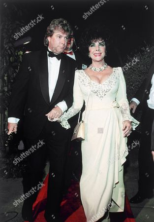 British-born American actress Elizabeth Taylor and husband Larry Fortensky arrive at Spago restaurant in West Hollywood, California, United States, following the 65th annual Academy Awards on March 29, 1993. Fortensky holds Taylor's Jean Hersholt Humanitarian Oscar