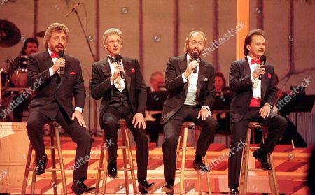 """BROTHERS The country group """"The Statler Brothers"""" perform May 7,1992 in Nashville, Tenn. They, are, from left: Harold Reid, Phil Balsley, Don Reid, and Jimmy Fortune. After nearly 40 years of touring, the Statler Brothers are calling it quits. The Statler Brothers' last concert will be Nov. 1. The Grammy-winning country music group has released more than 60 albums"""