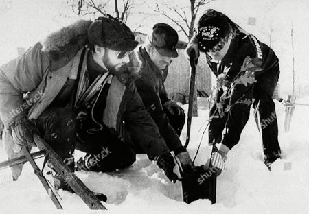 U.S. Vietnam Veterans Geoffrey Stainer, left, Hugh Beebe, and Brian Burke, right, plant an oak tree on Steiner's farm, at Cushing, Minn. in memory of Jason Rother, a marine who died in a training exercise. Steiner plans to plant 58,000 trees in memory of those who died in Vietnam. A donation by a Coors beer distribution today saved the farm from foreclosure