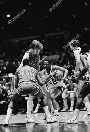 Villanovas Gary McClain (22) looks for a way out of a tight situation in first half action in the Big East semi finals at Madison Square Garden, New York. St. Johns Bill Goodwin (35) and Bill Wennington (23) close in as Villanovas John Pinone (45) and Stewart Granger (10) look on