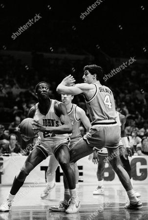 Walter Berry St. John's University forward Walter Berry, left, looks for an open man as he is tightly guarded by Syracuse University center Rony Seikaly during the first half of their Big East Conference championship game on at New York's Madison Square Garden. St. John's went on to win 70-69