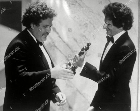 """British actor and writer Colin Welland, left, accepts an Oscar for the best screenplay from Jerzy Kosinski, during the 54th annual Academy Awards presentation, Los Angeles, . Welland was honoured for his screenplay, """"Chariots of Fire"""