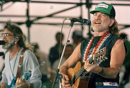 Willie Nelson performs during opening set at the FarmAid benefit concert at Champaign, Illinois