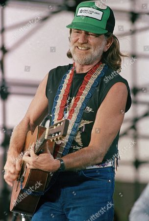 Stock Image of Willie Nelson performs during opening set at the FarmAid benefit concert at Champaign, Illinois
