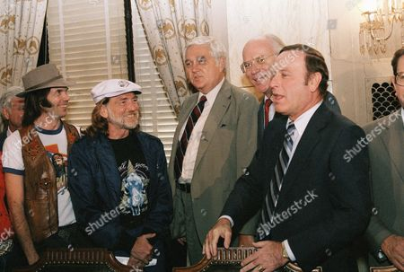 Country and Western singer Willie Nelson, second from left, and rock musician Neil Young, left, meet with members of the Senate Agriculture Committee on Capitol Hill in Washington D.C. in an attempt to lobby for legislation that would boost farm income. From left are, Young, Nelson, Sens. Mark Andrews, R-N.D.; Patrick Leahy, D-Vt.; and Alan Dixon, D-Ill. Nelson will be hosting a Farm Aid concert on Sept. 22 to raise funds for farmers at Champaign, Illinois