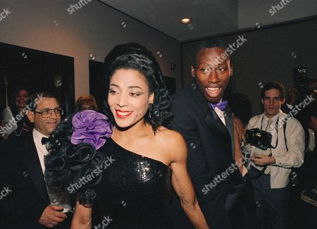 Florence Griffith Joyner, center, and her husband Al Joyner, right, attend the ninth annual Women's sports Foundation Awards on in New York. Joyner was named McDonald's Amateur Athlete of the year