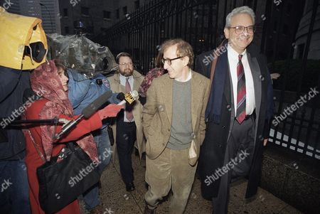 Shows director Woody Allen trading grins with a pursuing television reporter as he arrives at State Supreme Court in Manhattan, New York, for a hearing in which he requested more liberal visitation rights with his children during his ongoing dispute with ex-lover actress Mia Farrow. Dylan Farrow renewed molestation allegations against Allen, claiming the movie director sexually assaulted her when she was 7 after he and actress Mia Farrow adopted her