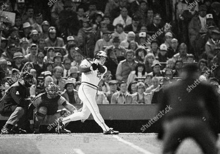 Baltimore Orioles batter Jim Dwyer watches his sole home run head out in the first inning of World Series opener with the Philadelphia Phillies in Baltimore. The homerun came off Phillies starter John Denny