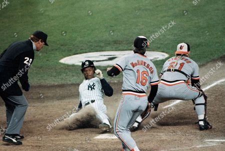 Rickey Henderson scores for the New York Yankees on a double by Willie Randolph in the first inning, against the Baltimore Orioles at Yankee Stadium, Sept. 16, 1986. Orioles pitcher Scott McGregor backs up catcher John Stefero