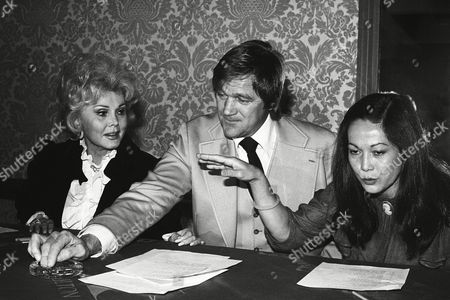 Zsa Zsa Gabor, Bo Svenson, Nancy Kwan Zsa Zsa Gabor, Bo Svenson and Nancy Kwan go through their lists of Golden Globe nominees during the announcement of nominations for the upcoming 39th annual presentations at the Beverly Hilton Hotel in Beverly Hills, California