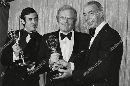 Roone Arledge, Joe DiMaggio, Danny Lewin Emmy winners for Outstanding Achievement in Sports Programming Roone Arledge, center, executive producer of the series and Danny Lewin, left, co-producer, pose with presenter and Yankee great Joe DiMaggio in Los Angeles, Cailf