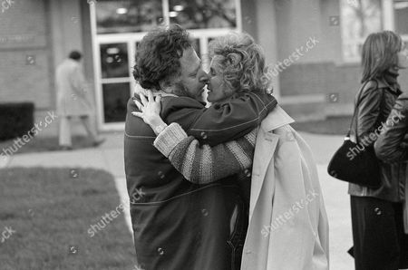Stock Image of Goldstein Pornographic magazine publisher Al Goldstein kisses his wife Gena, right, as they leave the Federal Building in Kansas City, Kansas, after Goldstein's obscentiy trial was declared a mistrial
