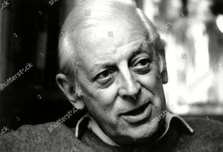 ALISTAIR COOKE Journalist Alistair Cooke poses in his home in New York City on